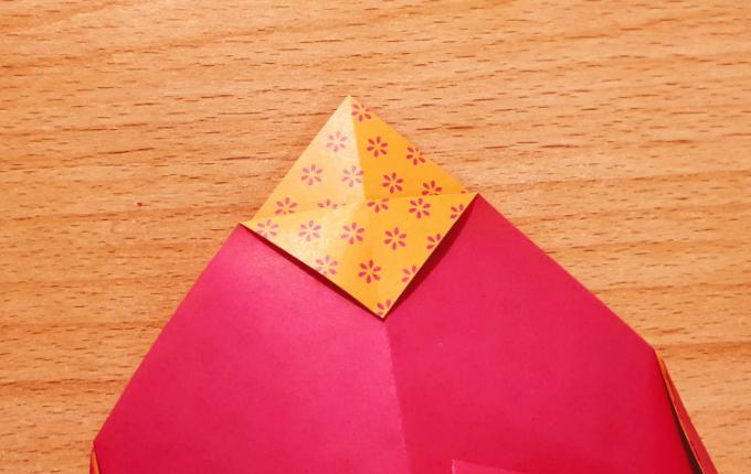 Origami Huhn Kopf wird umgefaltet